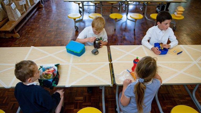 File photo dated 18/05/20 of children eating lunch in segregated positions at Kempsey Primary School in Worcester. Boris Johnson is working with the Education Secretary on a 'catch-up' package for children who missed out on learning during lockdown.