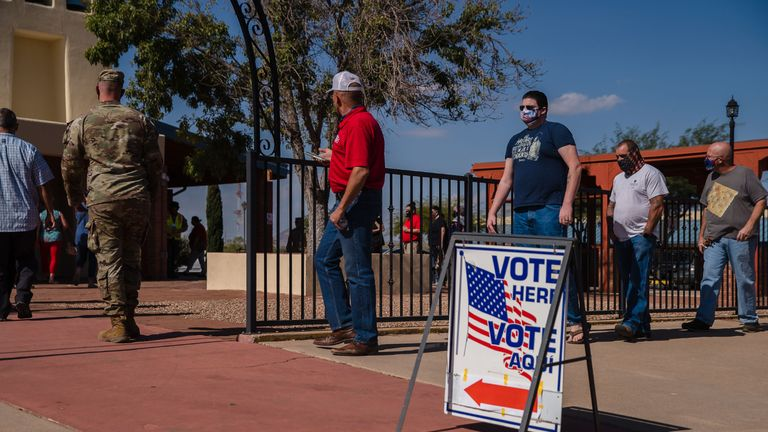 "People wait in line to vote in front of a polling station at St. Andrew the Apostle Parish in Sierra Vista, Arizona on November 3, 2020. - The United States started voting Tuesday in an election amounting to a referendum on Donald Trump's uniquely brash and bruising presidency, which Democratic opponent and frontrunner Joe Biden urged Americans to end to restore ""our democracy."" (Photo by ARIANA DREHSLER / AFP) (Photo by ARIANA DREHSLER/AFP via Getty Images)"