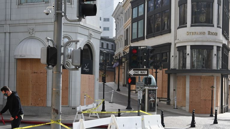 Stores on Rodeo Drive, the world renowned shopping street in Beverly Hills, California, are boarded up and closed to vehicular and pedestrian traffic on November 3, 2020 as a precaution against possible violence on the day of the US presidential election. - Americans were voting on Tuesday under the shadow of a surging coronavirus pandemic to decide whether to reelect Republican Donald Trump, one of the most polarizing presidents in US history, or send Democrat Joe Biden to the White House. (Photo by Robyn Beck / AFP) (Photo by ROBYN BECK/AFP via Getty Images)