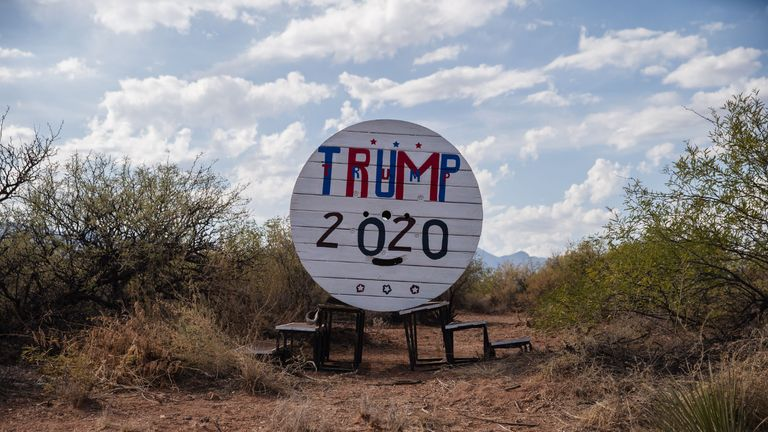 "A ""Trump 2020"" signs sits in a lot in Sierra Vista, Arizona on November 3, 2020. - Americans were voting on Tuesday under the shadow of a surging coronavirus pandemic to decide whether to reelect Republican Donald Trump, one of the most polarizing presidents in US history, or send Democrat Joe Biden to the White House. (Photo by ARIANA DREHSLER / AFP) (Photo by ARIANA DREHSLER/AFP via Getty Images)"