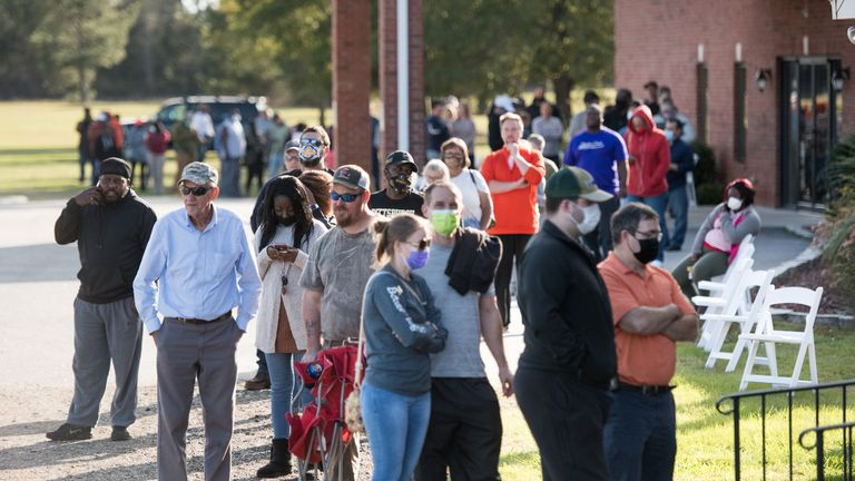 EFFINGHAM, SC - NOVEMBER 03: Voters wait in line to cast ballots at Savannah Grove Baptist Church on November 3, 2020 in Effingham, South Carolina. After a record-breaking early voting turnout, Americans head to the polls on the last day to cast their vote for incumbent U.S. President Donald Trump or Democratic nominee Joe Biden in the 2020 presidential election. (Photo by Sean Rayford/Getty Images)