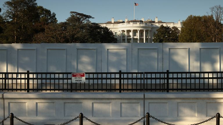 WASHINGTON, DC - NOVEMBER 02: The south side of the White House is seen behind layers of fencing less than 24 hours before Election Day November 02, 2020 in Washington, DC. Extra layers of fencing have been in place for several months around the White House after the violence that followed George Floyd's murder by police in Minneapolis earlier this year. (Photo by Chip Somodevilla/Getty Images)