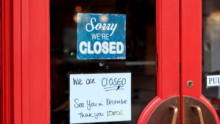 A closed sign outside a cafe in Leicester, on the first day of a second national lockdown for England.