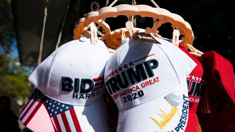 WASHINGTON, DC - NOVEMBER 05: Hats for sale supporting Democratic presidential nominee Joe Biden and U.S. President Donald Trump hang for sale near the White House, on November 5, 2020 in Washington, DC. With many critical battleground states still not announcing the results of their vote count, the presidential election is still too close to call. (Photo by Al Drago/Getty Images)