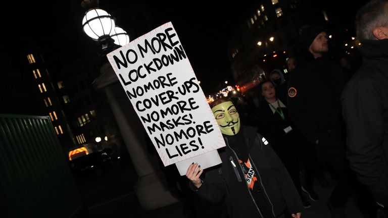 People take part in the Million Mask March anti-establishment protest at Trafalgar Square in London, on the first day of a four week national lockdown for England.