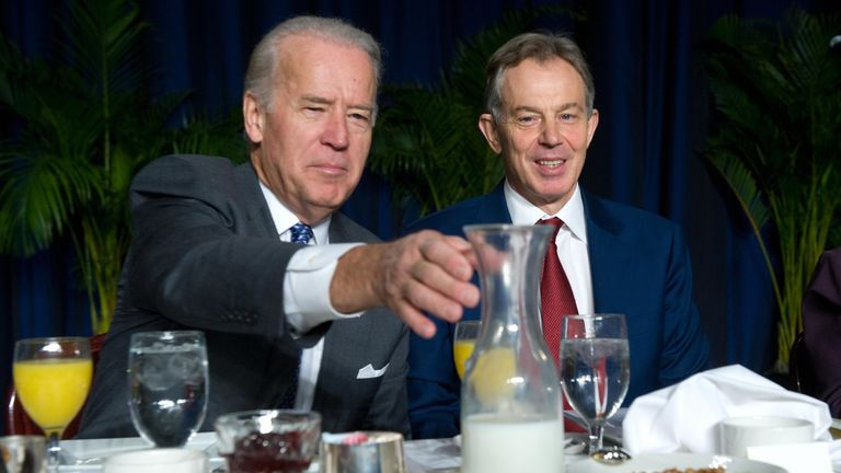 US Vice President Joe Biden reaches for the milk alongside former British Prime Minister Tony Blair during the National Prayer Breakfast at the Washington Hilton in Washington, DC, February 5, 2009. AFP PHOTO / Saul LOEB (Photo credit should read SAUL LOEB/AFP via Getty Images)