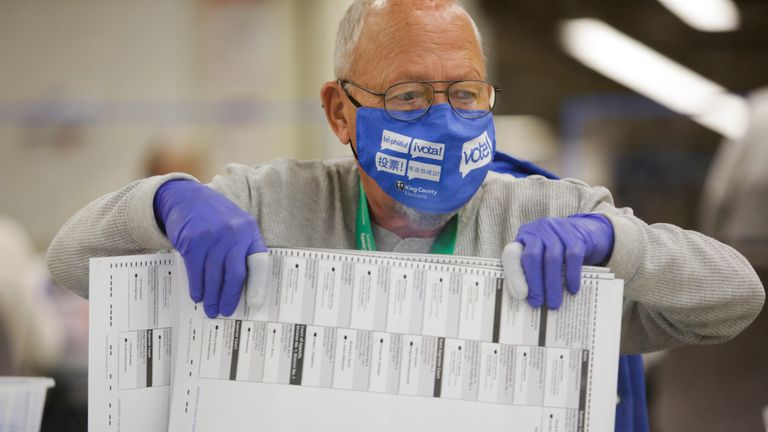 Charles Sandberg, an election worker in Kent, Washington, opened the ballot envelope in Washington on November 3, 2020, at the County County Election Office, a tenant in Washington. - Send Donald Trump, one of the most polarizing presidents in U.S. history, or Democrat Joe Biden to the White House as Americans vote Tuesday in the shadow of a carrier coronavirus epidemic to decide whether to elect a Republican. (Photo by Jason Redmond / AFP) (Photo by Jason Redmond / AFP Getty Images)