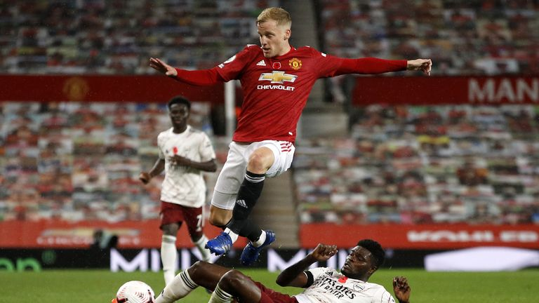 Manchester United's Donny van de Beek jumps over a tackle during the Premier League match at Old Trafford, Manchester.