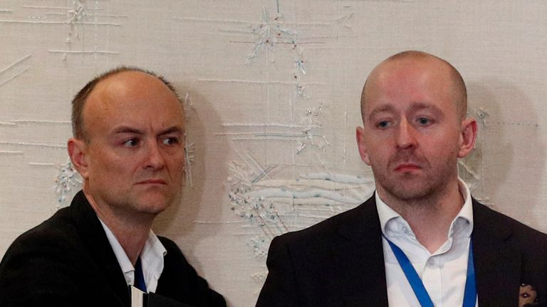 WATFORD, ENGLAND - DECEMBER 04: Downing Street former special advisor Dominic Cummings (L) and Director of Communications Lee Cain (R) attend British Prime Minister Boris Johnson's press conference at the NATO summit at the Grove hotel on December 4, 2019 in Watford, England. France and the UK signed the Treaty of Dunkirk in 1947 in the aftermath of WW2 cementing a mutual alliance in the event of an attack by Germany or the Soviet Union. The Benelux countries joined the Treaty and in April 1949 expanded further to include North America and Canada followed by Portugal, Italy, Norway, Denmark and Iceland. This new military alliance became the North Atlantic Treaty Organisation (NATO). The organisation grew with Greece and Turkey becoming members and a re-armed West Germany was permitted in 1955. This encouraged the creation of the Soviet-led Warsaw Pact delineating the two sides of the Cold War. This year marks the 70th anniversary of NATO. (Photo by Adrian Dennis - WPA Pool/Getty Images)