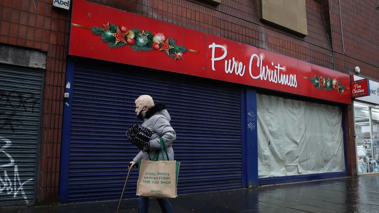 A member of the public walks passed a closed Christmas shop in Glasgow. Parts of the west of Scotland could move into Level 4 restrictions later this week, with First Minister Nicola Sturgeon to announce her decision later today. Under the toughest restrictions, non-essential shops will be closed, along with bars, restaurants, hairdressers and visitor attractions, whilst schools remain open