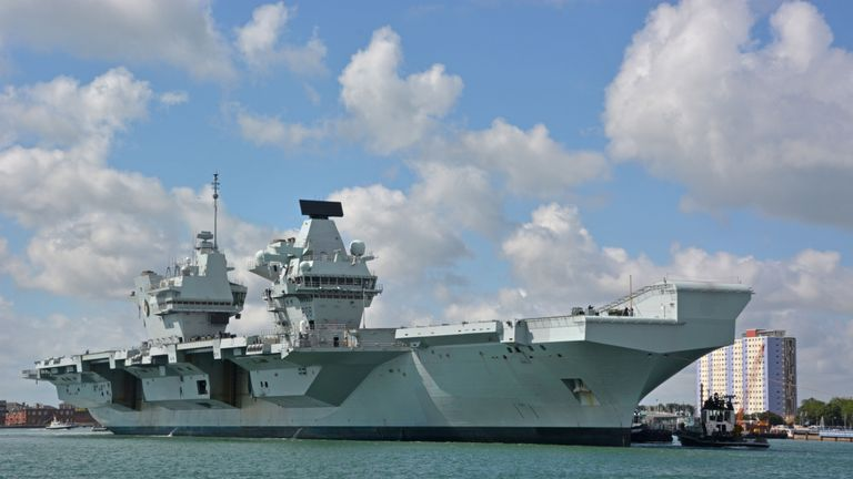 The Royal Navy aircraft carrier HMS Queen Elizabeth arrives back in Portsmouth Naval Base after carrying out sea and flight tests with F35B Lightning jets to prepare it for Carrier Strike Group readiness ahead of its first operational deployment next year.