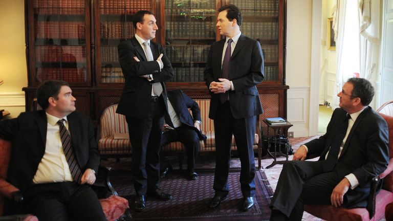 LONDON, ENGLAND - MARCH 23:  Chancellor of the Exchequer George Osborne chats with Principle Private Secretary to George Osbourne Dan Rosen Field as, Financial Secretary to the Treasury Mark Hoban (R) looks on before leaving No11 Downing Street to pose for photographs for this year's budget on March 23, 2011 in London, England.  The Chancellor is expected to implement further measures to tackle the United Kingdom's deficit when he presents the budget to Parliament. The UK Consumer Prices Index (CPI) annual rate of inflation has risen to 4.4%, the highest since October 2008, increasing pressure on the Bank of England to raise interest rates and slow inflation. (Photo by Stefan Rousseau-WPA Pool/Getty Images)