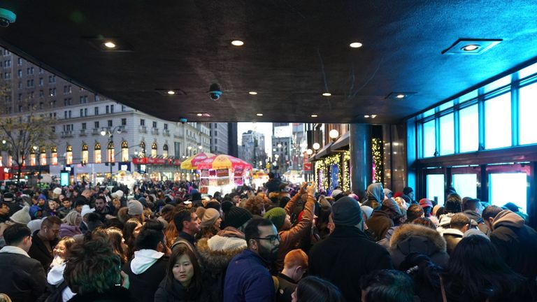 Shoppers wait to enter Macys department store scheduled to open at 5pm on Thanksgiving Day for Black Friday specials on November 28, 2019 in New York. (Photo by Bryan R. Smith / AFP) (Photo by BRYAN R. SMITH/AFP via Getty Images)