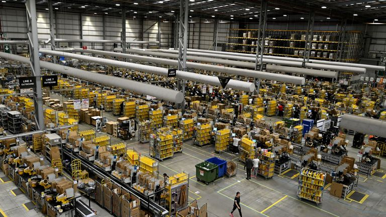 Amazon workers sort and pack items at the Amazon Fulfilment Centre in Peterborough, east England on November 27, 2019, as preparations are underway for the annual Black Friday Sale. (Photo by DANIEL LEAL-OLIVAS / AFP) (Photo by DANIEL LEAL-OLIVAS/AFP via Getty Images)