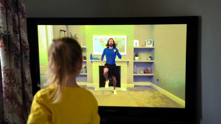 NEWCASTLE UNDER LYME, UNITED KINGDOM - MARCH 23: Four-year-old Lois Copley-Jones, who is the photographer's daughter, takes part in a live streamed broadcast of PE with fitness trainer Joe Wicks on the first day of the nationwide school closures on March 23, 2020 in Newcastle Under Lyme, United Kingdom. Coronavirus (COVID-19) pandemic has spread to at least 182 countries, claiming over 10,000 lives and infecting hundreds of thousands more. (Photo by Gareth Copley/Gareth Copley)