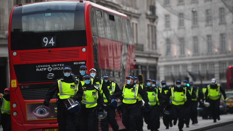 Police at Oxford Circus during an anti-lockdown protest in London.