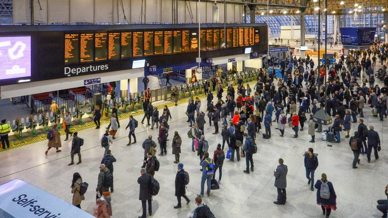 London, Feb 13, 2019: Many people in front of time board in rush hour at Waterloo train station, London, England.Waterloo station, a central London railway terminus
