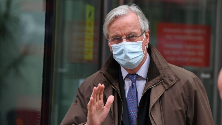 EU chief negotiator Michel Barnier wearing a protective face covering to combat the spread of the coronavirus, waves to members of the media as he leaves a conference centre as negotiations on a trade deal between the EU and the UK continue in London on November 28, 2020. - Britain's chief negotiator David Frost on Friday said a post-Brexit trade deal with the European Union could still be secured, despite a looming deadline and deadlock on key areas. (Photo by DANIEL LEAL-OLIVAS / AFP) (Photo by DANIEL LEAL-OLIVAS/AFP via Getty Images)