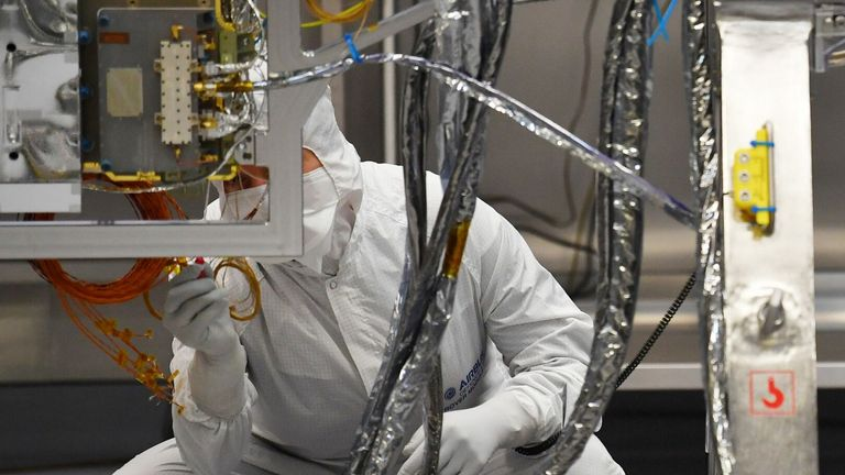 Technicians work on the newly-named Rosalind Franklin ExoMars rover at the Airbus Defense and Space facility in Steven, north London on February 7, 2019. (Photo by BEN STANSALL / AFP) (Photo credit should read BEN STANSALL / AFP by Getty Images )