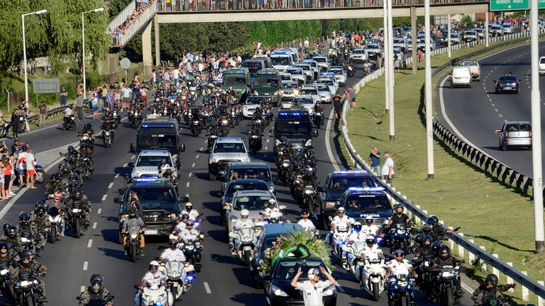 Scores of vehicles followed Maradona's coffin to the cemetary