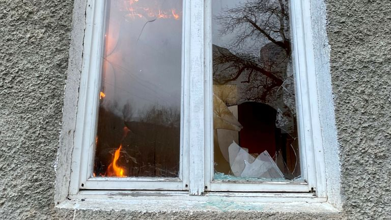 Flames burn through a window