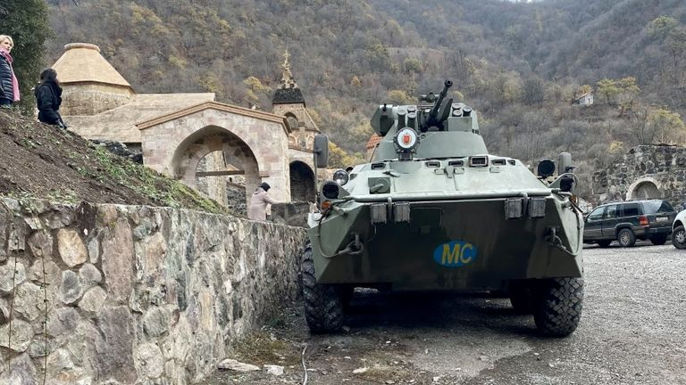 A Russian tank sits in the courtyard at Dadivank monastery