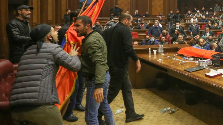 Protesters react inside the parliament, after Armenian Prime Minister Nikol Pashinyan said he had signed an agreement with leaders of Russia and Azerbaijan to end the war on Tuesday, in Yerevan, Armenia November 10, 2020. Vahram Baghdasaryan/Photolure via REUTERS ATTENTION EDITORS - THIS IMAGE HAS BEEN SUPPLIED BY A THIRD PARTY.