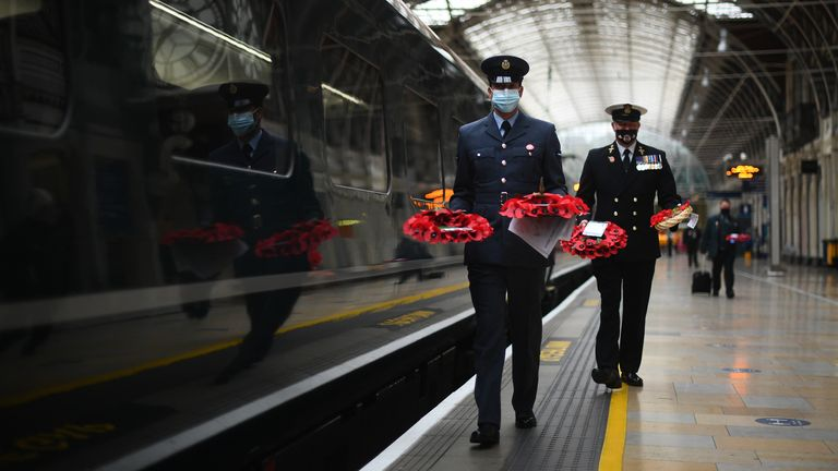 Military personnel carry poppy wreaths at Paddington Station in London, for 'Poppies to Paddington'. Great Western Railway (GWR) and The Veterans Charity are transporting memorial wreaths from around the UK on GWR train services into London Paddington where the wreaths will be laid around the station's war memorial for the two minutes silence to remember the war dead on Armistice Day.