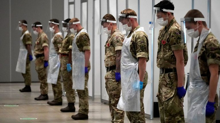 LIVERPOOL, ENGLAND - NOVEMBER 11: Soldiers observe a 2 minute silence to mark Remembrance Day at Liverpool Exhibition Centre, where the UK military are assisting with mass COVID-19 testing on November 11, 2020 in Liverpool, United Kingdom. Wednesday marked 102 years since the armistice that marked the end of World War I. (Photo by Christopher Furlong/Getty Images)
