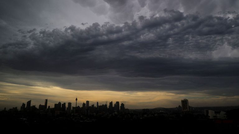 SYDNEY, AUSTRALIA - NOVEMBER 29: Clouds are seen over the Sydney skyline as a cool change moves in on November 29, 2020 in Sydney, Australia. The Bureau of Meteorology has forecast heatwave conditions in NSW this weekend, with temperatures expected to exceed 40 degrees across the state. (Photo by Jenny Evans/Getty Images)