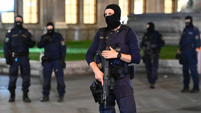 "Armed policemen stand guard in front of the state opera in the center of Vienna on November 2, 2020, following a shooting. - Two people, including one attacker, have been killed in a shooting in central Vienna, police said late November 2, 2020. Vienna police said in a Twitter post there had been ""six different shooting locations"" with ""one deceased person"" and ""several injured"", as well as ""one suspect shot and killed by police officers"". (Photo by Joe Klamar / AFP) (Photo by JOE KLAMAR/AFP via"