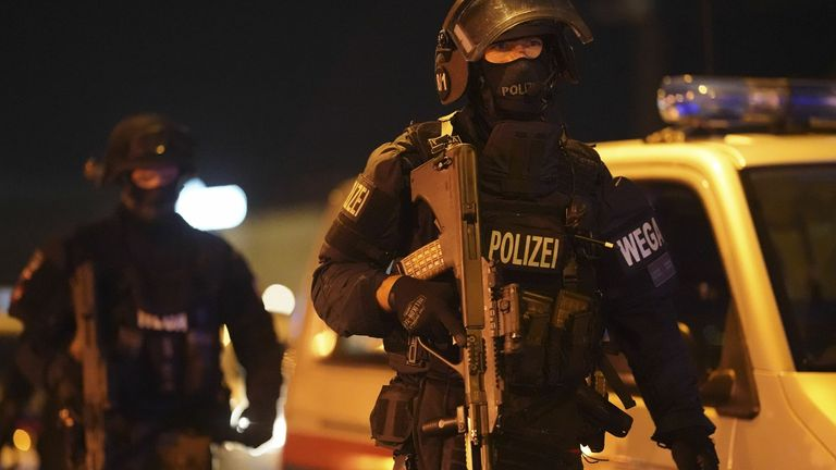 "A heavily armed policeman stands guard at Schwedenplatz place in the center of Vienna on November 2, 2020, following a shooting in the city center. - Two people, including one attacker, have been killed in a shooting in central Vienna, police said late November 2, 2020. Vienna police said in a Twitter post there had been ""six different shooting locations"" with ""one deceased person"" and ""several injured"", as well as ""one suspect shot and killed by police officers"". (Photo by GEORG HOCHMUTH / APA"