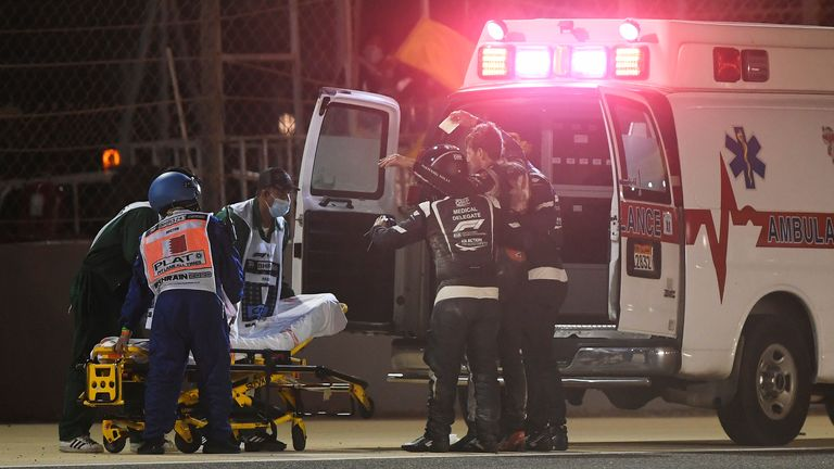 BAHRAIN, BAHRAIN - NOVEMBER 29: Romain Grosjean of France and Haas F1 is pictured being helped into an ambulance after a crash during the F1 Grand Prix of Bahrain at Bahrain International Circuit on November 29, 2020 in Bahrain, Bahrain. (Photo by Rudy Carezzevoli/Getty Images)