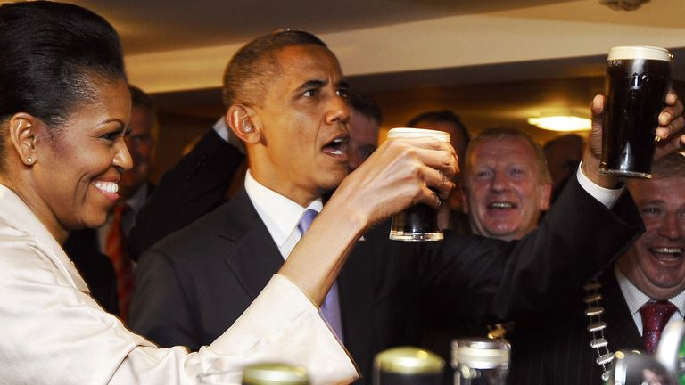 Barack and Michelle Obama sampling a Guinness in Moneygall, where his great-great-great grandfather hailed from, in 2011