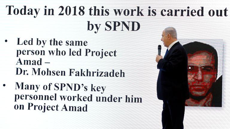 Benjamin Netanyahu in front of image of Mohsen Fakhrizadeh