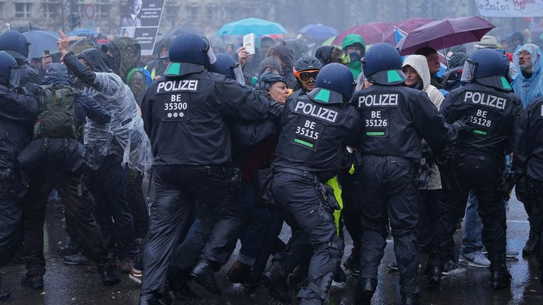 Protesters were sprayed with water as they struggled against a line of police