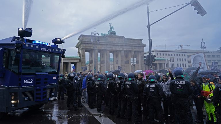 Protesters gathered at the Brandenburg Gate at the edge of a cordon around parliament