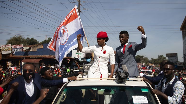 KAMPALA, UGANDA - NOVEMBER 03: Bobi Wine parades though the streets through crowds of supporters on November 03, 2020 in Kampala, Uganda. Popular singer Robert Kyagulanyi Ssentamu, better known by his stage name of H.E. Bobi Wine, is set to appear before the Independent Electoral Commission this morning to be nominated to stand against incumbent Yoweri Museveni in the upcoming Presidential elections in Uganda. He will be join candidate two former military Generals, Mugisha Muntu and Henry Tumuku