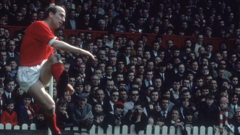 English footballer Bobby Charlton taking a corner for Manchester United, 1968