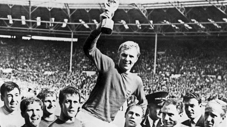 WORLD CUP-1966-ENGLAND-MOORE-CUP File picture of England's national soccer team captain Bobby Moore holding aloft the Jules Rimet trophy as he is carried by his teammates including (from L) Gordon Banks, Alan Ball, Roger Hunt, Geoff Hurst, Ray Wilson, George Cohen and Bobby Charlton, following England's victory over Germany (4-2 in extra time) in the World Cup final 30 July 1966 at Wembley stadium in London. England's 1966 World Cup winner Alan Ball died from a heart attack overnight, his family