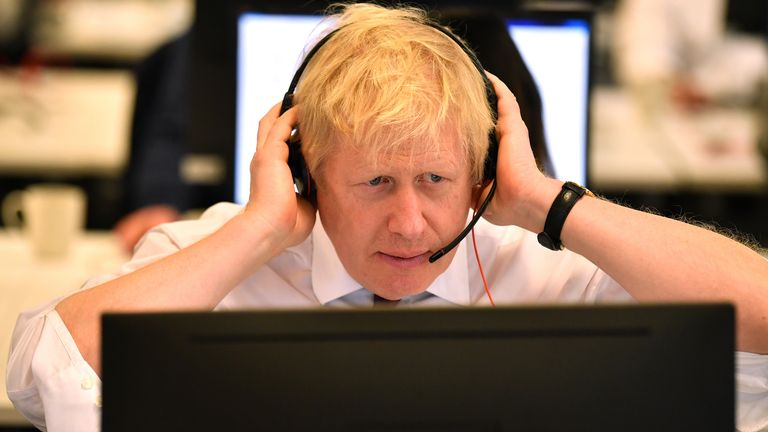 LONDON, UNITED KINGDOM - DECEMBER 8: Britain's Prime Minister Boris Johnson speaks to a caller as he mans the phones at the Conservative Campaign Headquarters Call Centre on December 8, 2019 in central London. Britain will go to the polls on December 12, 2019 to vote in a pre-Christmas general election. (Photo by Ben Stansall - WPA Pool/Getty Images)