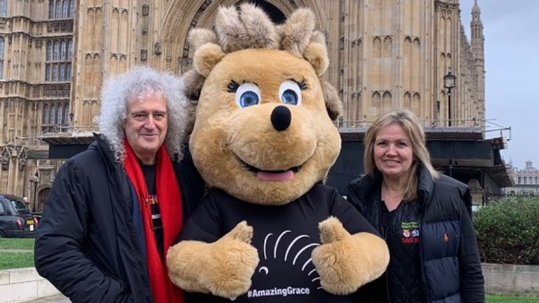 Brian May and Anne Brummer with mascot, Grace the hedgehog. Pic: Save Me Trust