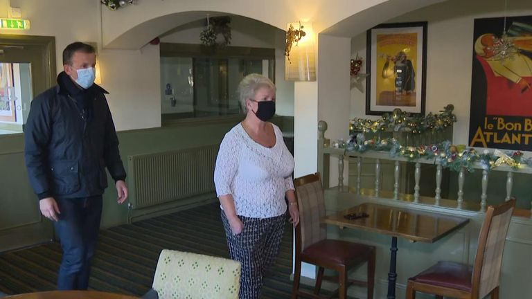 The John Harvey Arms landlady Sue Diaper and Alex Rossi walk through her pub which is just inside Tier 3 in Bristol.