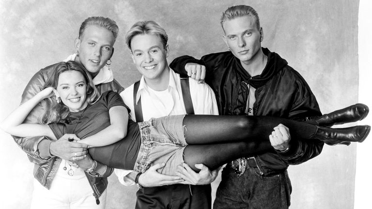 Kylie Minogue, Jason Donovan, Matt and Luke Goss of Bros during the recording of the Band Aid 2 charity single 'Do They Know It's Christmas' PWL studios in South London on 03 December 1989