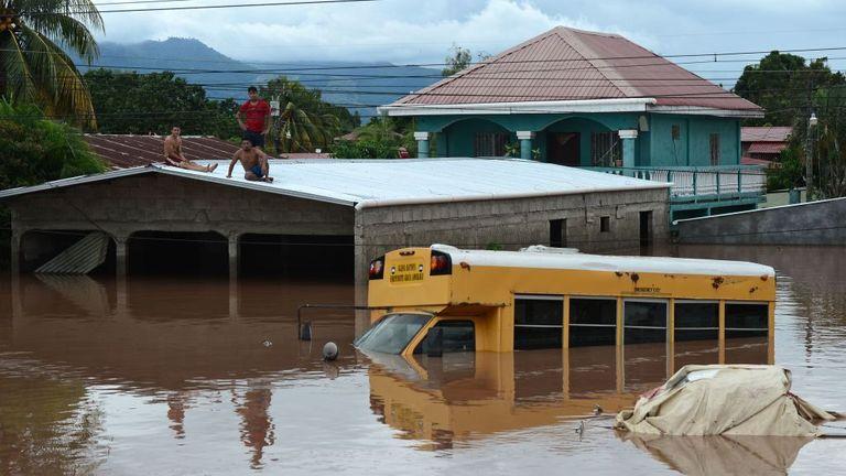 A bus is seen partially submerged after Hurricane Eta hit Honduras last week