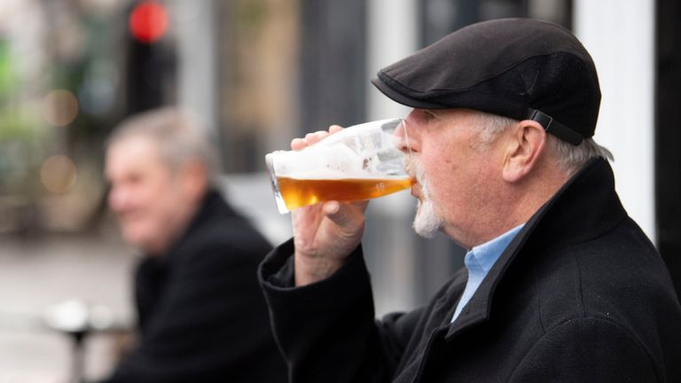 """CARDIFF, WALES - OCTOBER 23: A man drinks a pint outside the Goat Major pub on October 23, 2020 in Cardiff, Wales. Wales will go into a national lockdown from Friday until November 9. People will be told to stay at home and pubs, restaurants, hotels and non-essential shops must shut. Primary schools will reopen after the half-term break, but only Years 7 and 8 in secondary schools can return at that time under new """"firebreak"""" rules. Gatheri"""