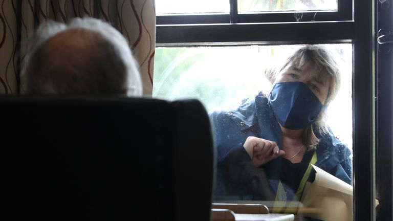 An elderly resident talks to a visitor through the window at nursing home in south London, as research has revealed that care home residents were more likely to die of Covid-19 in the UK than in any of the major European countries apart from Spain. Picture date: Wednesday July 1, 2020.