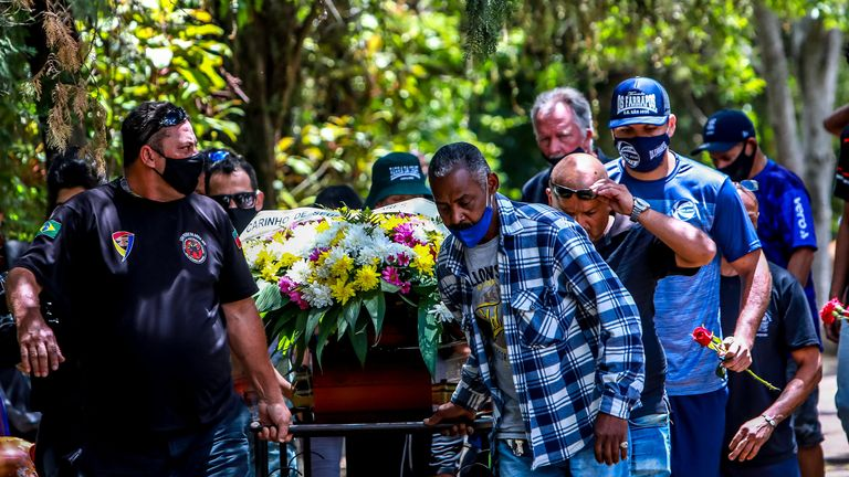 Relatives and friends of Joao Alberto Silveira Freitas, who died after being beaten by white security agents in a supermarket belonging to the Carrefour group, attend his funeral in Porto Alegre, Brazil, on November 21, 2020