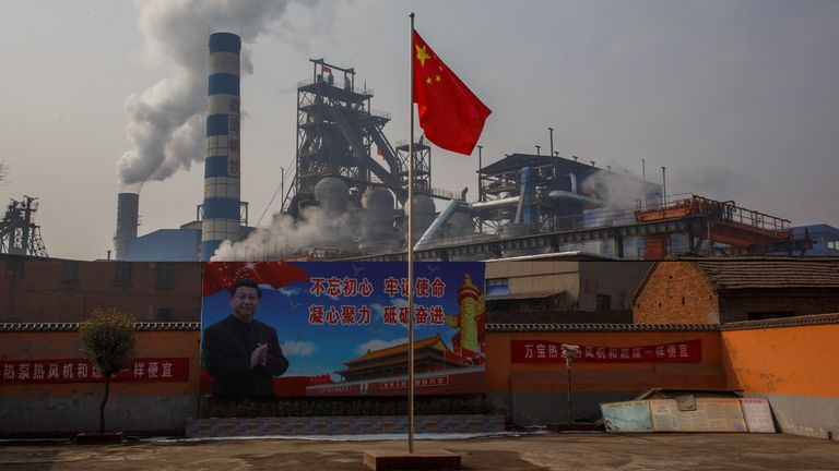 China's president Xi Jinping is pictured on a billboard outside a steel plant in Henan
