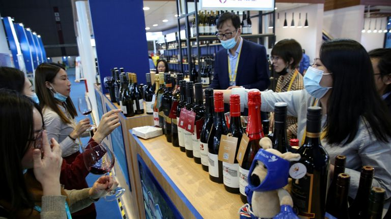 People taste red wine from Australia at the Food and Agricultural Products exhibition at the third China International Import Expo (CIIE) in Shanghai